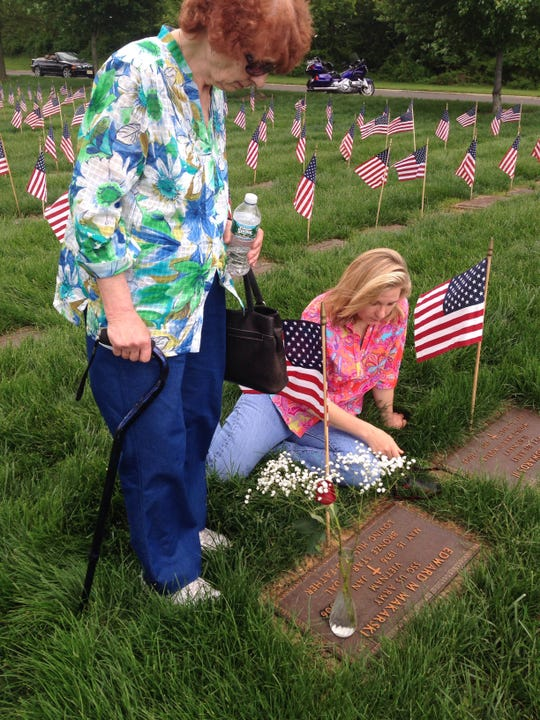 Former Gresytone Park Psychiatric Hospital patient J.M., with her daughter, Mary, at her husband's grave on May 25, 2014, less than four months before she was committed to Greystone.