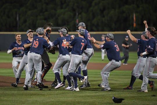 Auburn players celebrate after defeating Georgia Tech to win the Atlanta Regional on Sunday, June 2, 2019, in Atlanta, Ga.
