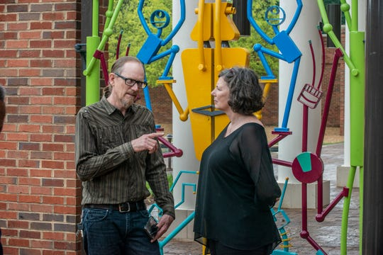 Montgomery artist Vincent Buwalda and MMFA director Angie Dodson at The Children's Gate. The Montgomery Museum of Fine Arts unveiled The Children's Gate on Thursday, June 6, 2019