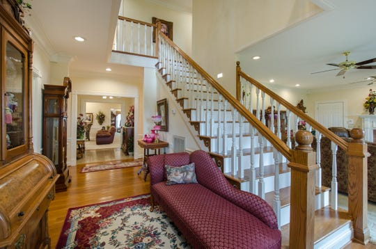 The home has more than 5,000 square feet of space and is decorated with Victorian-style furnishings.