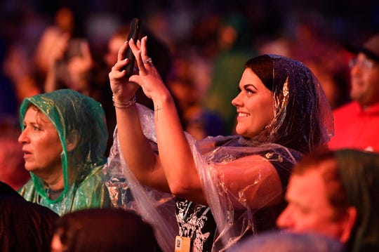 A fan takes a photo during the 2019 CMA Fest Thursday, June 6, 2019, at Nissan Stadium in Nashville, Tenn.