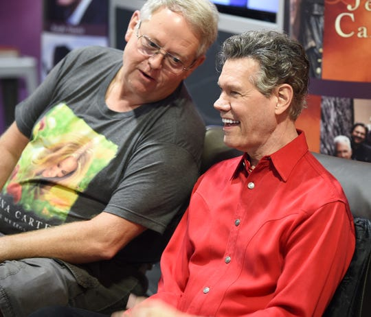 A fan interacts with Randy Travis during a meet-and-greet at 2019 CMA Fest Friday, June 7, 2019, in Nashville, Tenn.