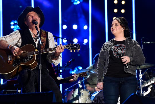 Kix Brooks and Ashley McBryde perform with the Brothers Osborne during the 2019 CMA Fest Thursday, June 6, 2019, at Nissan Stadium in Nashville, Tenn.