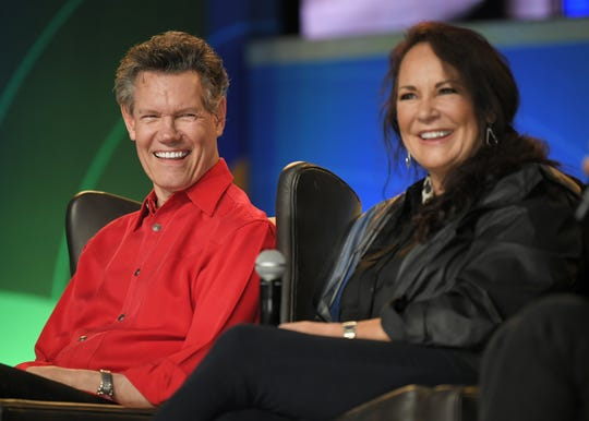 Randy Travis and his wife Mary interact with fans during a meet-and-greet at the 2019 CMA Fest Friday, June 7, 2019, in Nashville, Tenn.