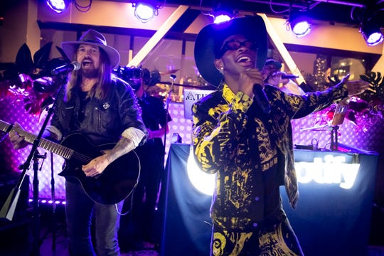 Lil Nas and Billy Ray Cyrus perform at the Spotify House at Ole Red in Nashville, Tenn., Friday, June 7, 2019.