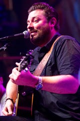 "Chris Young headlines the ""Raised on Country"" tour at the BankPlus Amphitheatre on Thursday."