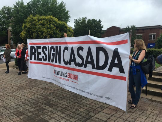 Protesters unveiled a banner calling for Speaker Glen Casada's immediate resignation during a gathering on the square in downtown Franklin on Friday, June 7, 2019.