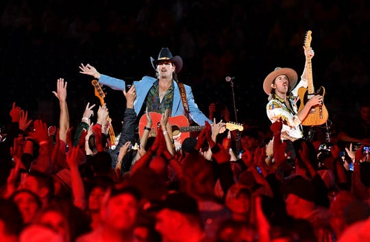 Midland performs in the middle of the crowd during the 2019 CMA Fest Thursday, June 6, 2019, at Nissan Stadium in Nashville, Tenn.