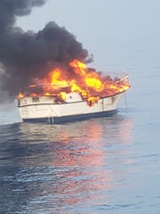 Two people were rescued by the Key West Express after they abandoned their 35-foot vessel when it caught fire about 30 miles southwest of Gordon Pass on June 6, 2019.