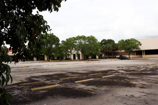 The parking lot has remained unkept as more and more storefronts have emptied.