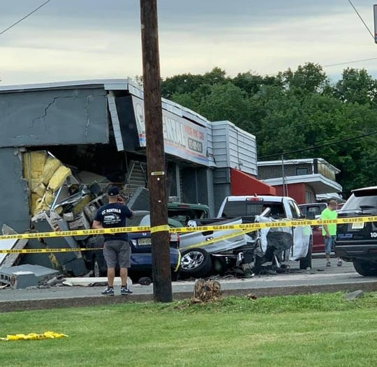 A car crash damaged a building on Route 23 in Wayne June 7, 2019.