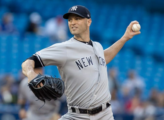 New York Yankees starting pitcher J.A. Happ throws to a Toronto Blue Jays batter during the first inning of a baseball game Thursday, June 6, 2019, in Toronto. (Fred Thornhill/The Canadian Press via AP)