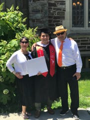 Isaiah Nieves Nieves (center) with his mother and father at his graduation from Princeton.