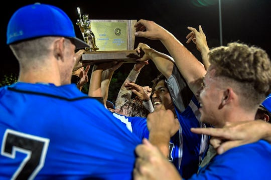 St. Mary's Kenny Quijano (3) hoists a trophy with teammates following a 4-3 win over Gloucester Catholic in a Non-Public B state championship game at Veterans Park in Hamilton Township Thursday, June 6, 2019.