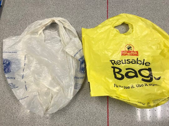 A thin, single-use plastic bag on the left has been banned in many towns. Many of those towns still allow stores to charge customers 10 to 25 cents for  thicker plastic bags like the one on the right. Hoboken is looking to ban all plastic carryout bags.