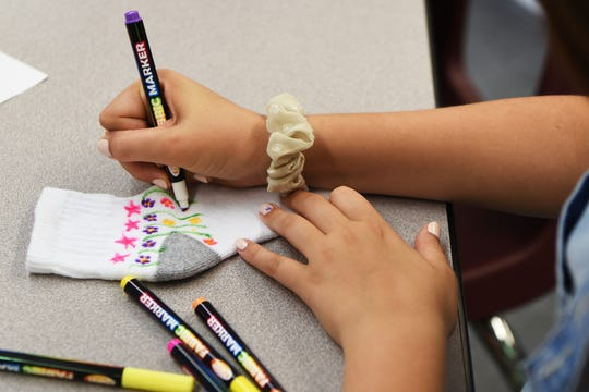 Sixth graders at Cavalini Middle School  in Upper Saddle River chose the Rock The Socks Foundation, Inc. as part of their service learning day activities. The foundation helps families of children who have Epidermolysis Bullosa (EB), a rare skin disease. Students decorate socks to raise awareness for those with EB on Friday June 7, 2019.