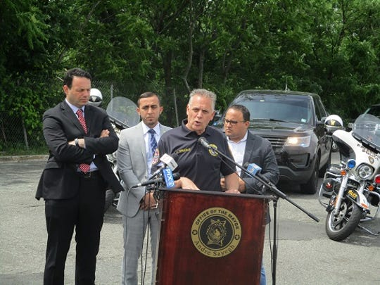 Public Safety Director Jerry Speziale announcing quality of life patrols. Behind him (from left) are Mayor Andre Sayegh, Councilman Al Abdelaziz and Councilman Flavio Rivera.