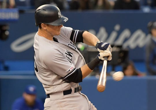 Jun 6, 2019; Toronto, Ontario, CAN;  New York Yankees second baseman DJ LeMahieu (26) hits an RBI single against Toronto Blue Jays in the fourth inning at Rogers Centre. Mandatory Credit: Dan Hamilton-USA TODAY Sports