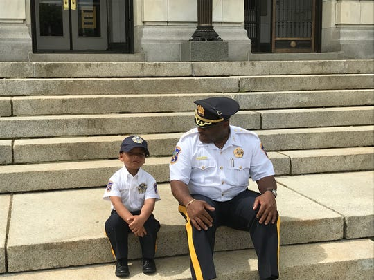 Parker Diez and Sheriff Cureton relaxing on the courthouse steps.