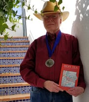 "New Mexico author Kent F. Jacobs' recent novel, ""Hopi Tea,"" has won the Silver Medal for Best Regional Fiction at a celebration on May 28 during the annual BookExpo in New York City."