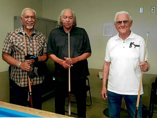 Carlos Hernández won the Munson Senior Center's monthly 8-ball billiards tournament held on Wednesday, May 29. Pictured left to right are May's winners:  First place, Carlos Hernández, second place Henry Telles and  third place, Jr Guevara.