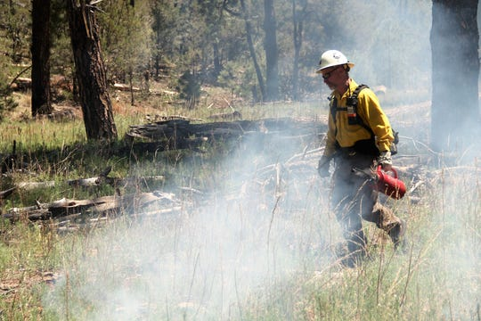 Ron Riise of the Lincoln National Forest lights a prescribed burn June 7.