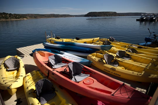Rental kayaks are stacked, Thursday, June 8, 2017, at the Navajo Lake Marina at Navajo Dam.