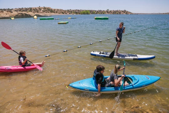 From left, Eli Brown, Kaityn Brown, Matthew Brown, bottom and Megan Brown enjoy the day, Friday, May, 18, 2018 on Farmington Lake.