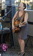 "Jill Cohn performs a song from a her new disc ""Balanced on the Rail"" during the Cottonwood Concert Series on Friday at the Farmington Public Library."