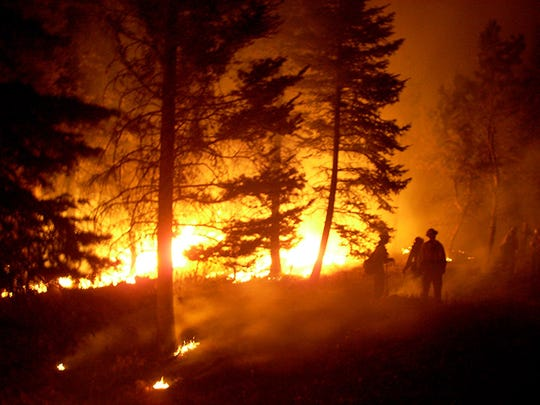 Firefighters battle a blaze at New Mexico's Bandelier National Monument in 2007.