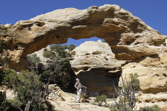Larry Beck examines the Crow Canyon Arch on Monday, Oct. 21, 2013,  in Crow Canyon.