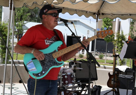 Robert Stallings plays bass for Mad Dog 20/20, Friday, June 7, 2019, during TGIF at the Farmington Civic Center.