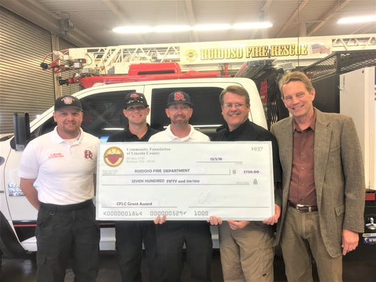 The Ruidoso Fire Department also was recognized with a grant from the CFLC. From left are Fire fighter Cody Wilson and Jeff Miles, Fire Chief Cody Thetford, village emergency manager Joe Kasuboski, and Riker Davis, CFLC Board chairman.