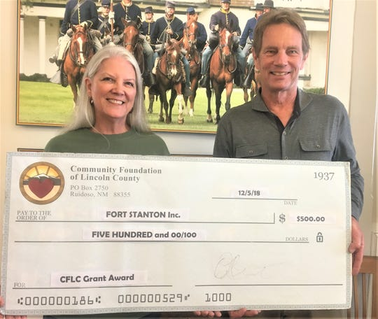 Fort Stanton Inc. was a grant recipient. From left are Lisa Dolle, Fort Stanton Board of Directors, and Riker Davis, CFLC Board Chairman.