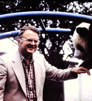 Ray Pawley, former animal curator, is greeted by a panda in 1984 at the Chapultepec Park Zoo in Mexico City.