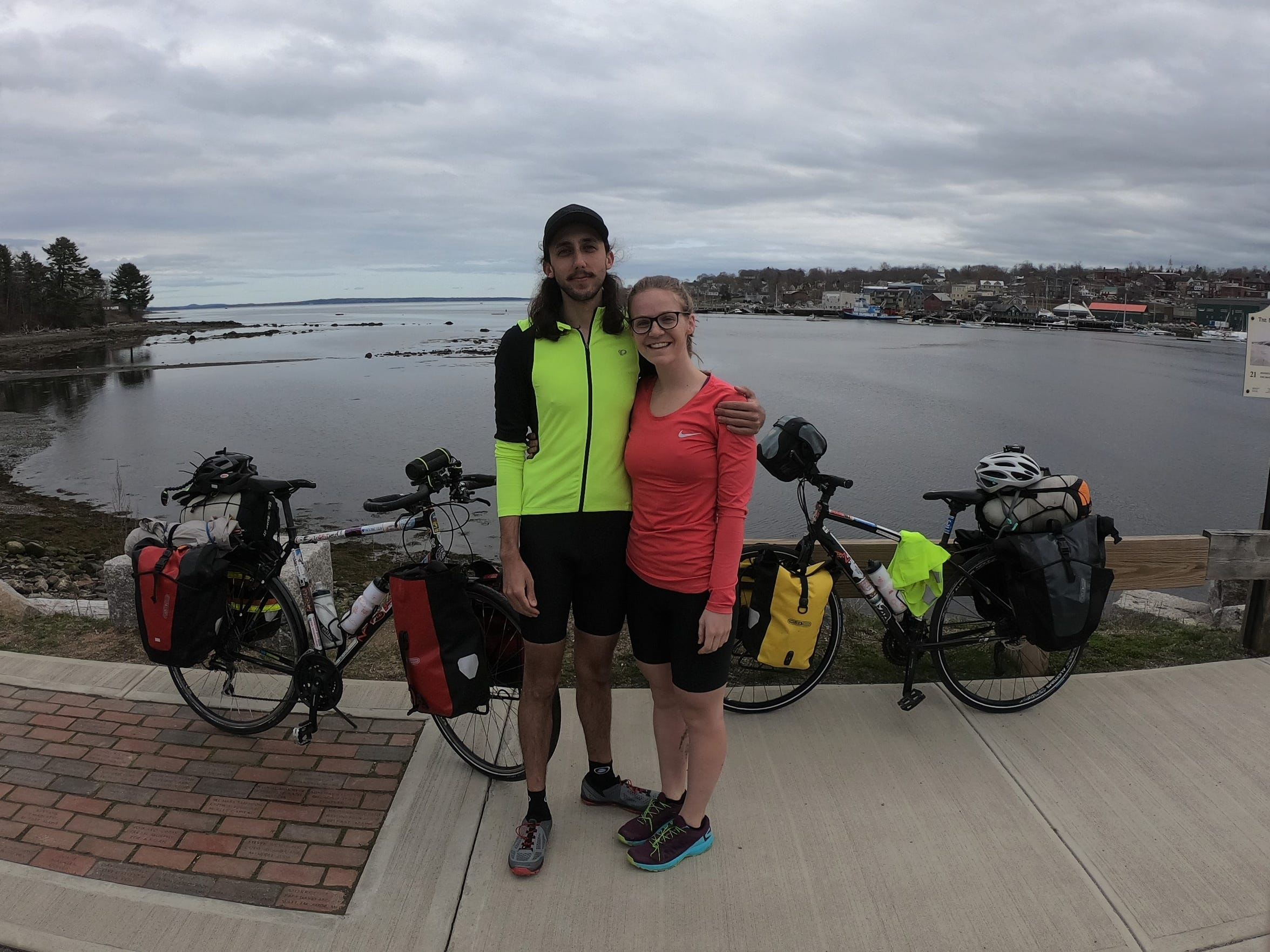 Daniel Thakur, 25, and Lauren Harrington, 24, a 2013 Novi High graduate, on the Maine coast as they start their 4,400 mile bike tour of the U.S.