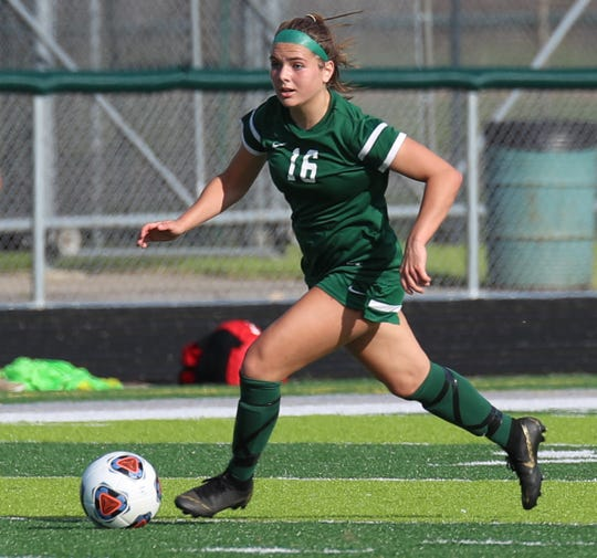 Novi's Jessie Bandyk dribbles up the field against Grand Blanc.