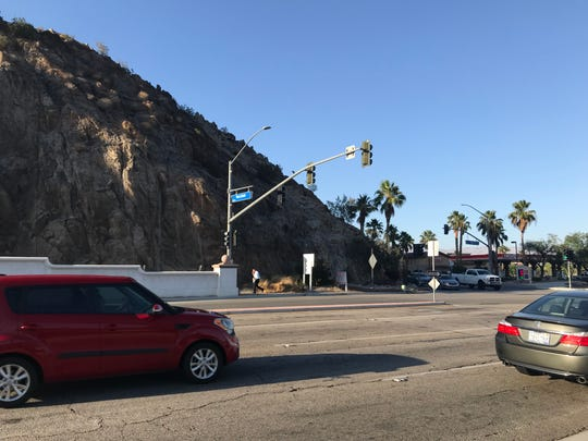 Indian Wells City Council members expressed safety concerns for cyclists and NEV users who might come from behind Point Happy shopping center and continue west on Highway 111 around this roadside mountain, at the Plaza La Quinta intersection.  On Thursday, June 6, 2019, the council cited safety concerns and Measure H in denying La Quinta's request for a border extension behind Point Happy shopping center to build a portion of its CV Link on property that was assumed was already in La Quinta's city limits.