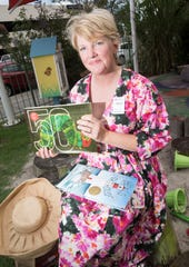 Crissy Nettles prepares for storytime at the Bodacious Brew Thru on Friday. Nettles is the manager of the new Bodacious Bookstore and Cafe opening in Southtowne later this summer.