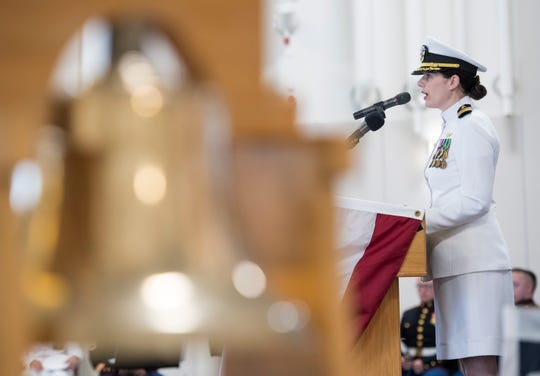 Cmdr. Lena Kaman, the new Helicopter Training Squadron Eight commanding officer, speaks during the change of command ceremony at Whiting Field on Friday.