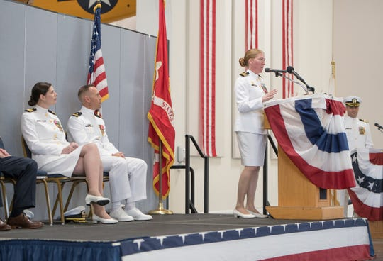 Cmdr. Jessica R. Parker, the outgoing commanding officer of Helicopter Training Squadron Eight, speaks Friday during a change of command ceremony at Whiting Field in Milton.