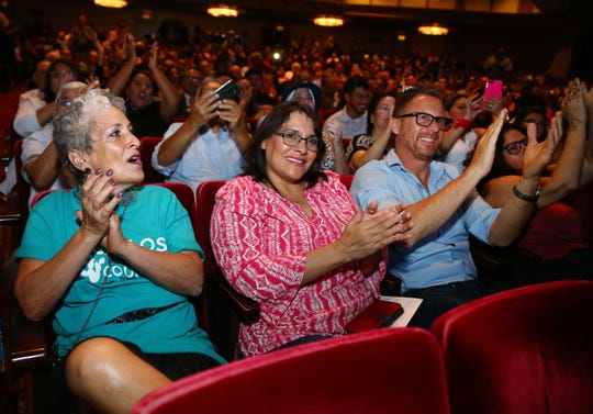 Supporters applaud as new City of Phoenix Councilman for District 8, Carlos Garcia, makes his first remarks during the inauguration ceremony on June 6, 2019, at the Orpheum Theatre in Phoenix, Ariz.