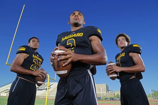 During their time at Saguaro High School Kam'ron Johnson (left), Christian Kirk (center) and Byron Murphy were teammates. They are seen in a photo taken Wednesday, Aug. 6, 2014 in Scottsdale, Ariz.
