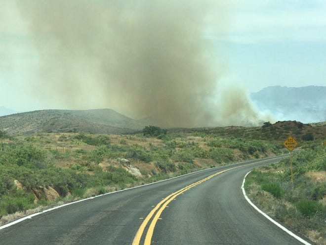 Smoke is seen from the Mountain Fire burning in the Tonto National Forest on the afternoon of June 7, 2019.