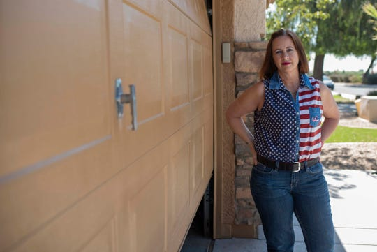 "Lisa Novotny, 52, poses for a portrait at her home in Surprise, Ariz. on June 6, 2019. Novotny was scammed out of $2,400 for a garage door that was never delivered by the ""Garage-Door Guy."" ""When you find someone who comes across as trustworthy — who comes to see you right after church — and then they rip you off, it makes it very difficult to trust someone again,"" she said."
