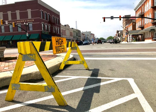 While the high water signs are ready at the corner of Madison and Perry streets, the record-high lake levels are not slowing business owners, officials and other stakeholders from growing downtown Port Clinton.