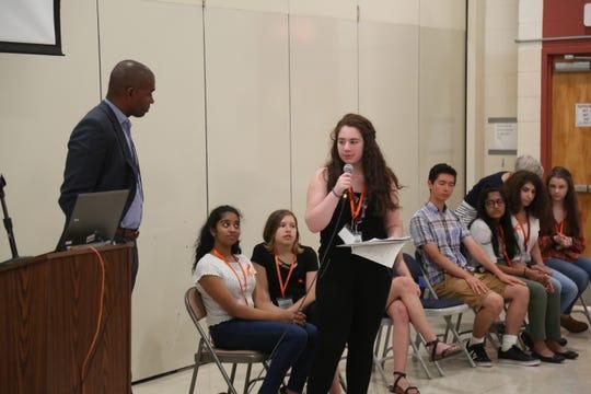 Arlington High School sophomore Gigi Goldfischer asks Rep. Antonio Delgado a question at the school Thursday.