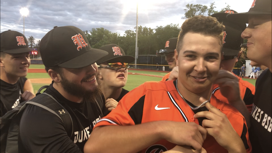 Marlboro baseball teammates playfully swarm Brendan Mahusky after the pitcher threw a one-hitter to beat Westlake in the Class B regional semifinal.