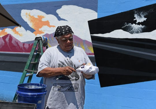 Reno artist Jack Malotte works on his mural on the back side of the Nevada Museum of Art on June 4, 2019. Malotte's  work on the Great Basin, whick will be on display in the Robert Z. Hawkins Gallery June 8 thru Octorber 20, 2019, focuses on contemporary Native American political issues.