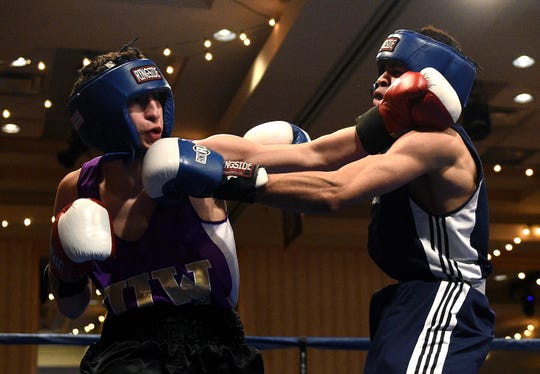 Nevada's JJ Mariano, left, connects against UNLV's Mike Alvarez during their 147-pound NCBA Western Regional bout at the Eldorado Hotel Casino in Reno in 2016.